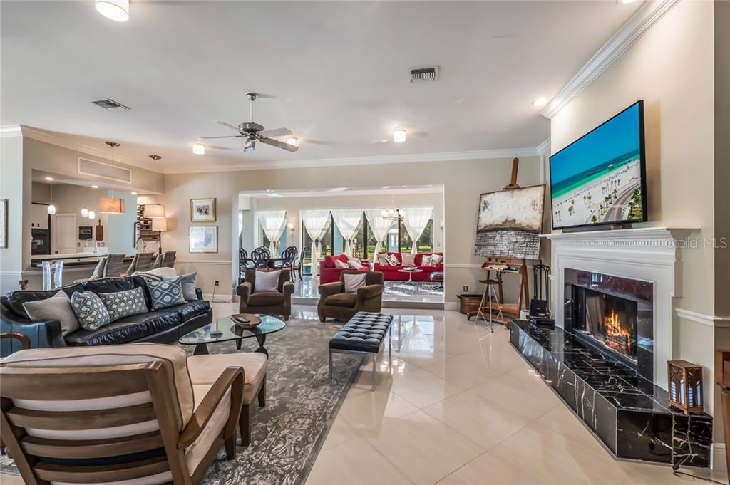 Architectural Details and Fireplace for Chilly Sarasota Winters - Single Family Home for sale at 5026 Kestral Park Way S, Sarasota, FL 34231 - MLS Number is A4203689