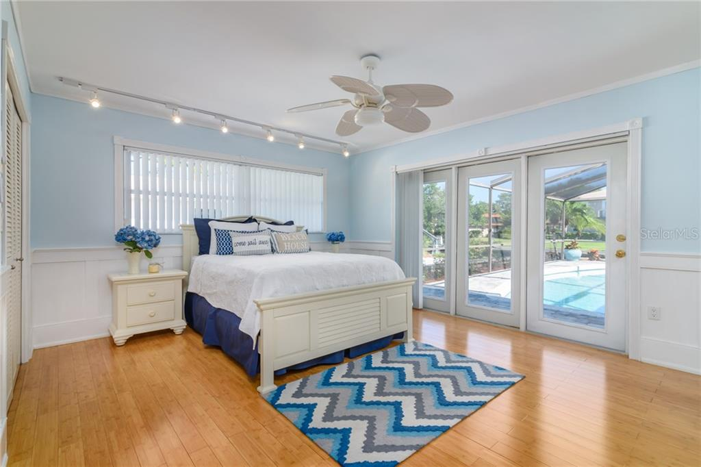 Master bedroom with access to lanai and swimming pool - Single Family Home for sale at 5439 Azure Way, Sarasota, FL 34242 - MLS Number is A4203969