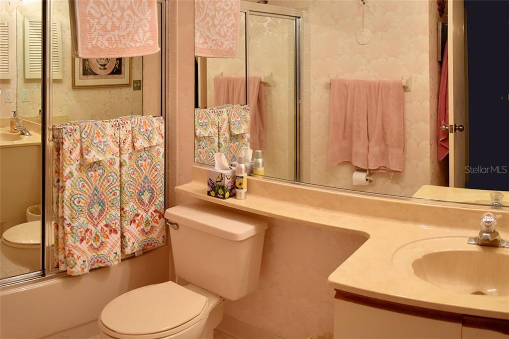 2nd Bathroom has Tub w/mirror doors. - Condo for sale at 1618 Starling Dr #105, Sarasota, FL 34231 - MLS Number is A4204864