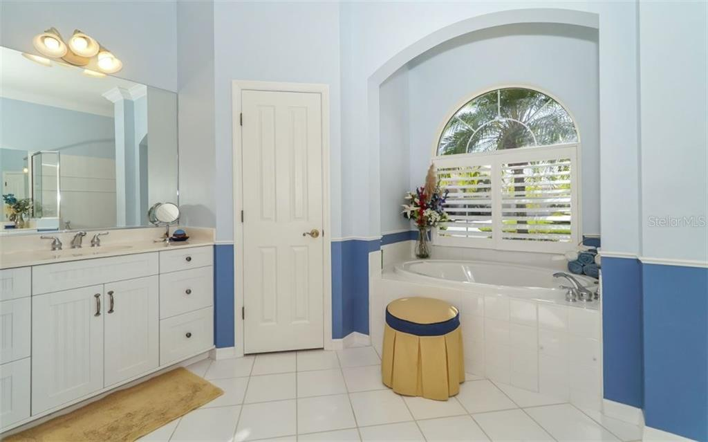 Master Bath with a Private Toilet,  two separate Vanities and Palladium window with Plantation Shutters - Single Family Home for sale at 460 Otter Creek Dr, Venice, FL 34292 - MLS Number is A4205372