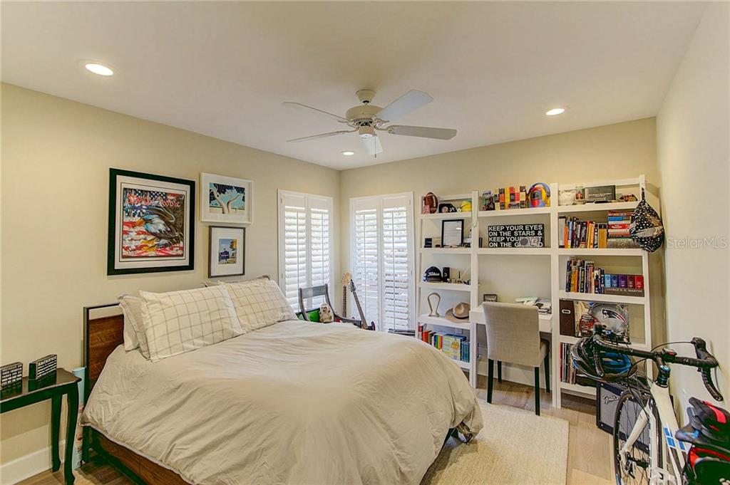 Bedroom 2, plantation shutters, recessed lighting and custom build closet. - Single Family Home for sale at 3508 Avenida Madera, Bradenton, FL 34210 - MLS Number is A4205393