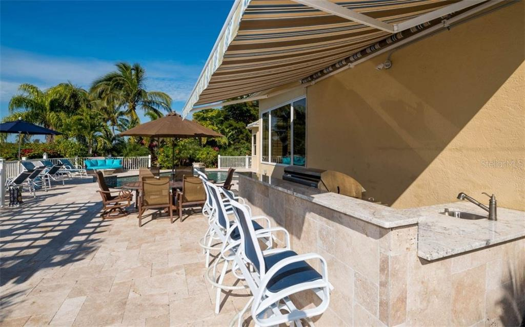 Several options for seating on this expansive deck! - Single Family Home for sale at 5824 Tidewood Ave, Sarasota, FL 34231 - MLS Number is A4205461