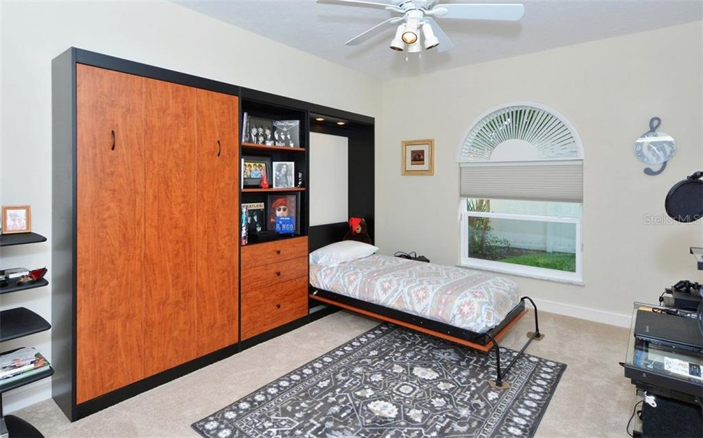 Bedroom # 3 with Murphy beds (optional) - Single Family Home for sale at 3882 Spyglass Hill Rd, Sarasota, FL 34238 - MLS Number is A4206477