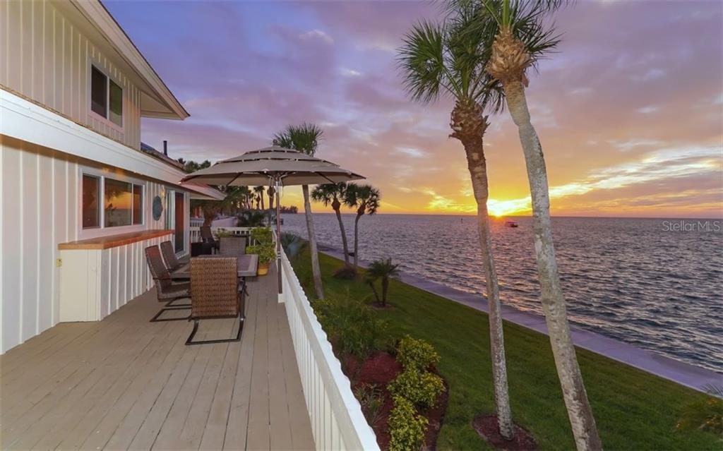 Back porch with beautiful sunset views - Single Family Home for sale at 148 Sand Dollar Ln, Sarasota, FL 34242 - MLS Number is A4206505