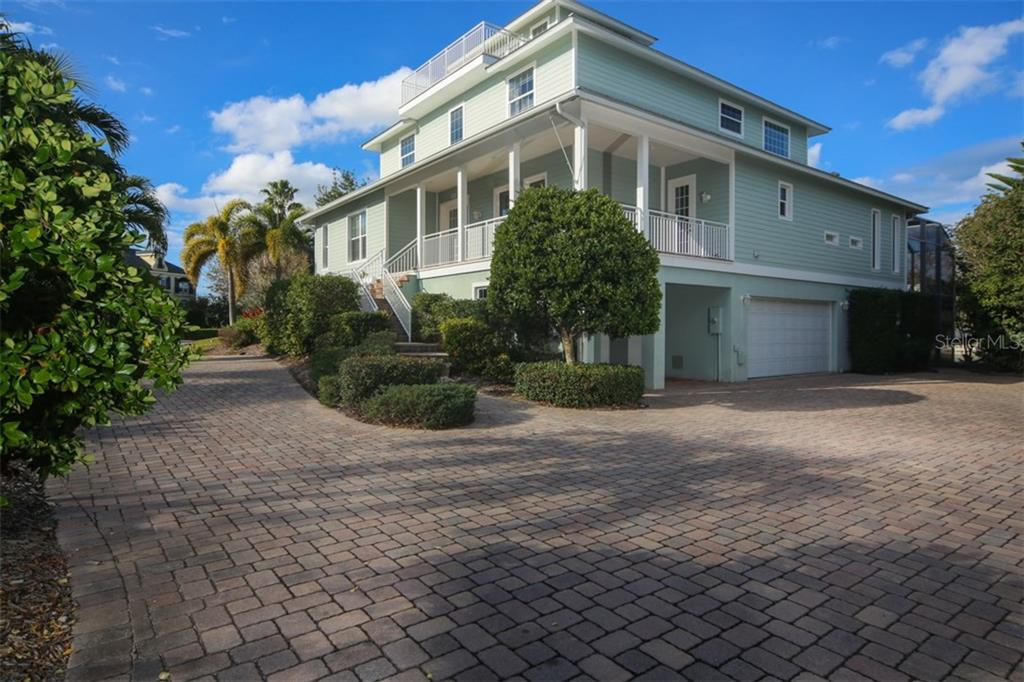 Expansive paver driveway - Single Family Home for sale at 7047 Hawks Harbor Cir, Bradenton, FL 34207 - MLS Number is A4206626