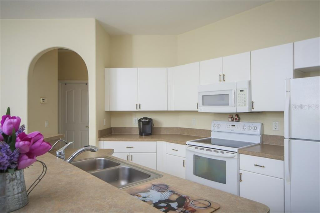 Kitchen - Single Family Home for sale at 1876 Bushnell Ave, North Port, FL 34286 - MLS Number is A4207073