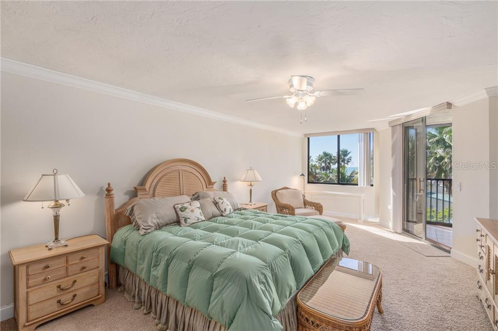 Master bedroom with sliders to covered balcony - Condo for sale at 5880 Midnight Pass Rd #511, Sarasota, FL 34242 - MLS Number is A4207131