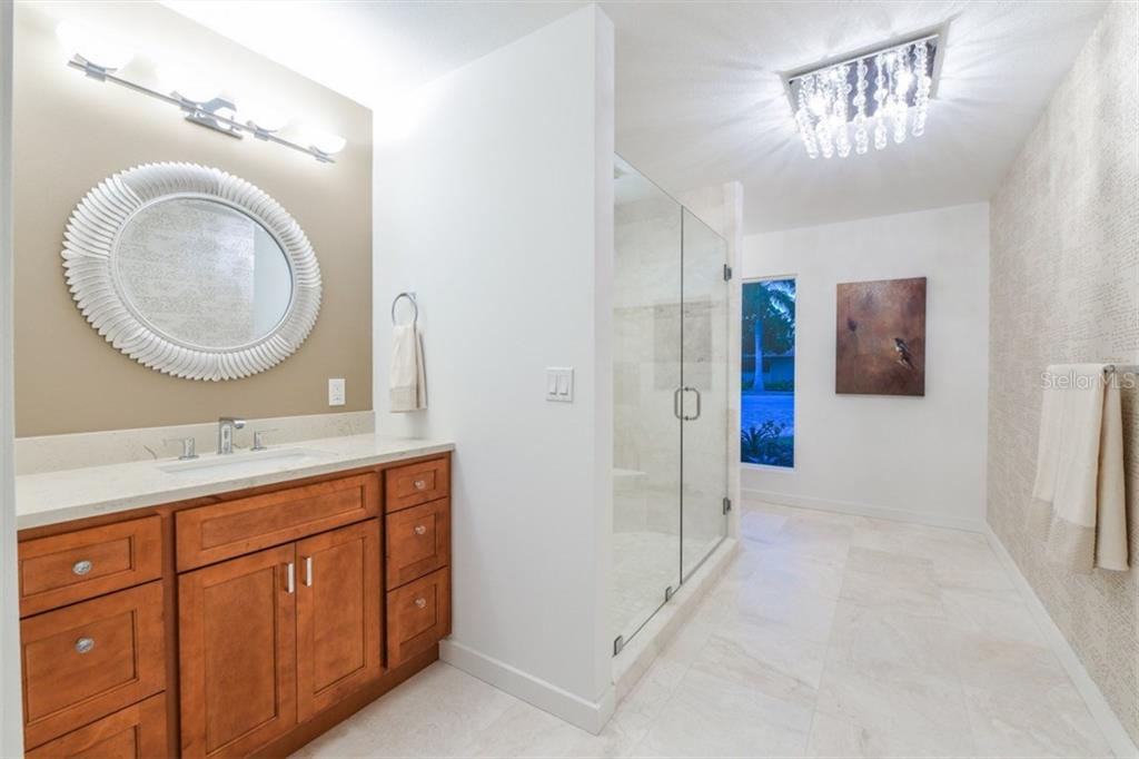 1 of 2 vanities in master bathroom - Single Family Home for sale at 460 Pheasant Dr, Sarasota, FL 34236 - MLS Number is A4208025