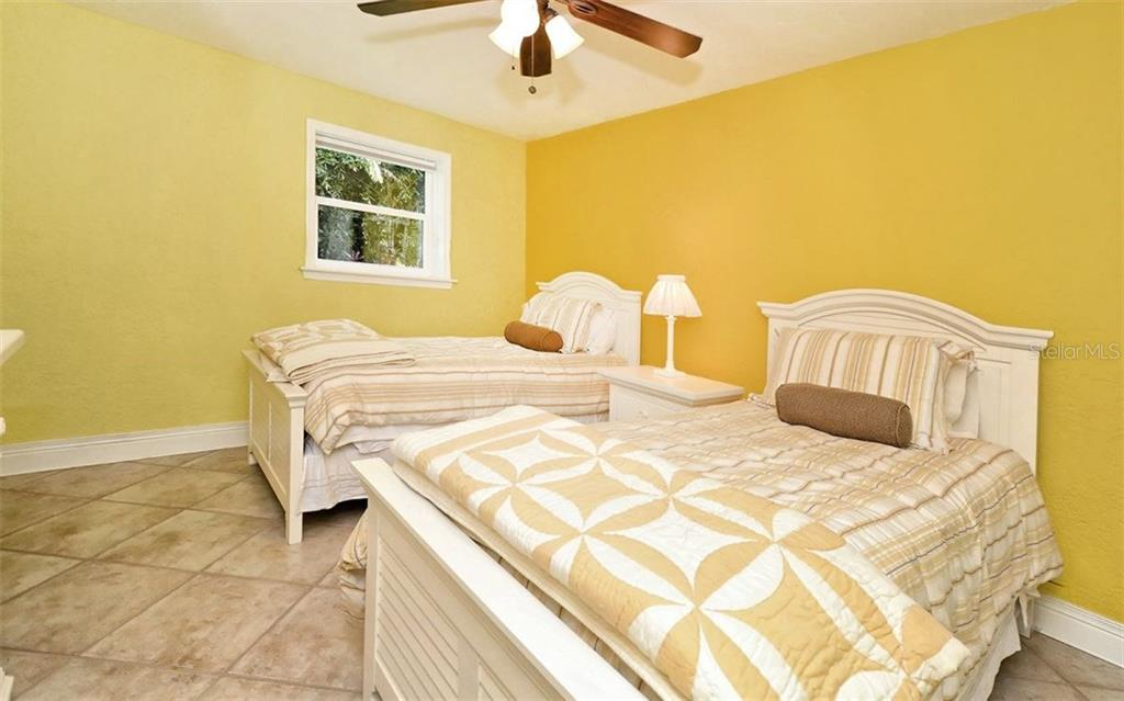 Lower Bedroom 1 - Single Family Home for sale at 141 Ogden St, Sarasota, FL 34242 - MLS Number is A4208039