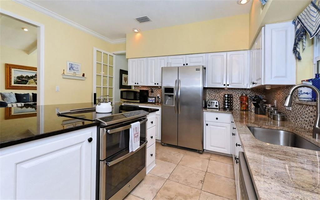 Kitchen with stainless steel appliances - Single Family Home for sale at 141 Ogden St, Sarasota, FL 34242 - MLS Number is A4208039