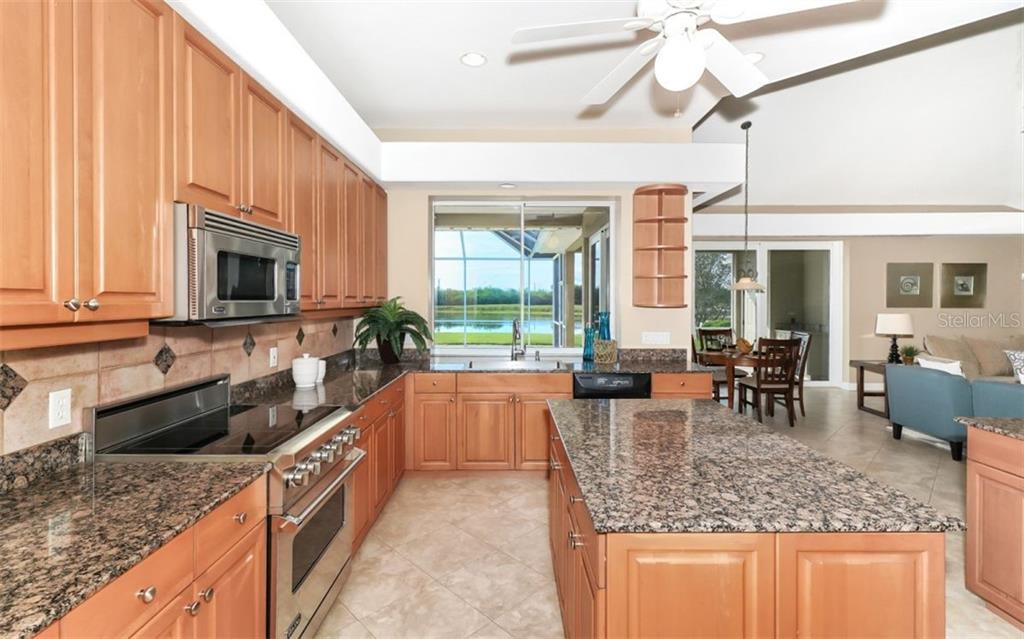 Kitchen with view of dinette and family room - Single Family Home for sale at 7389 S Serenoa Dr S, Sarasota, FL 34241 - MLS Number is A4208150