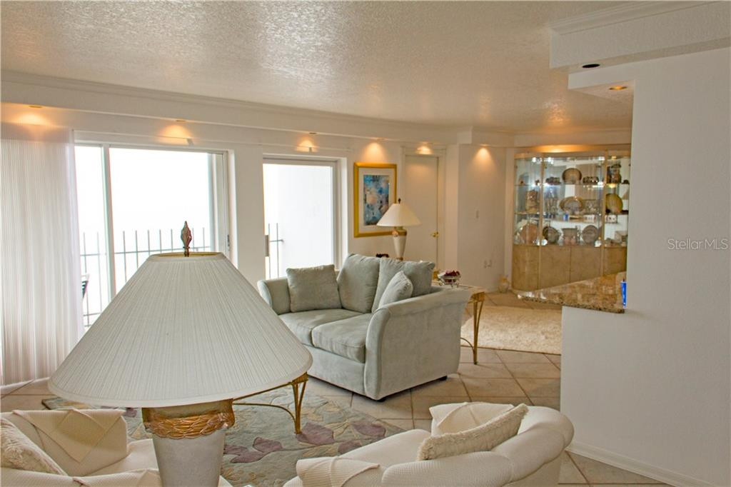 Living Room from Dining Room area - Condo for sale at Address Withheld, Sarasota, FL 34236 - MLS Number is A4208417