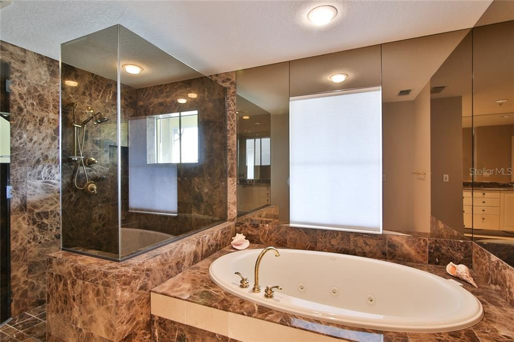Luxurious master bath w/ large jetted tub and abundance of marble - Condo for sale at 1310 Old Stickney Point Rd #e21, Sarasota, FL 34242 - MLS Number is A4209502