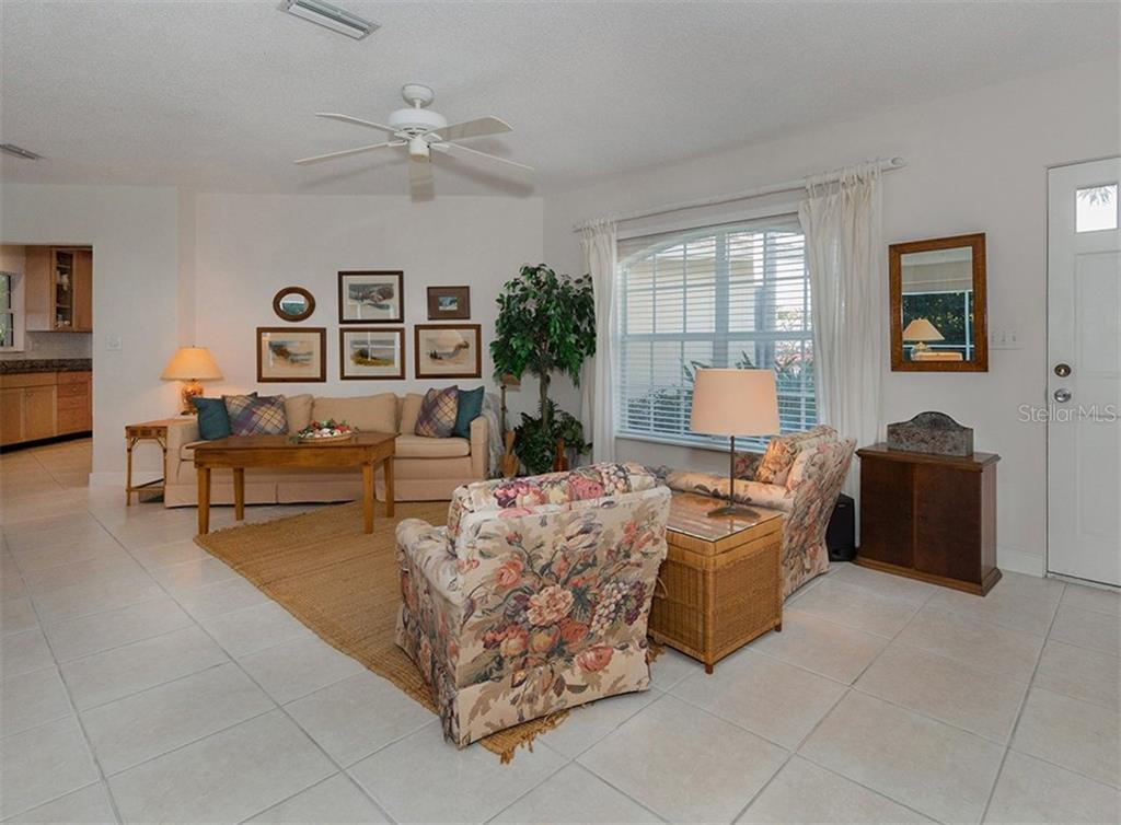 Living room - Single Family Home for sale at 445 Mahon Dr, Venice, FL 34285 - MLS Number is A4209507