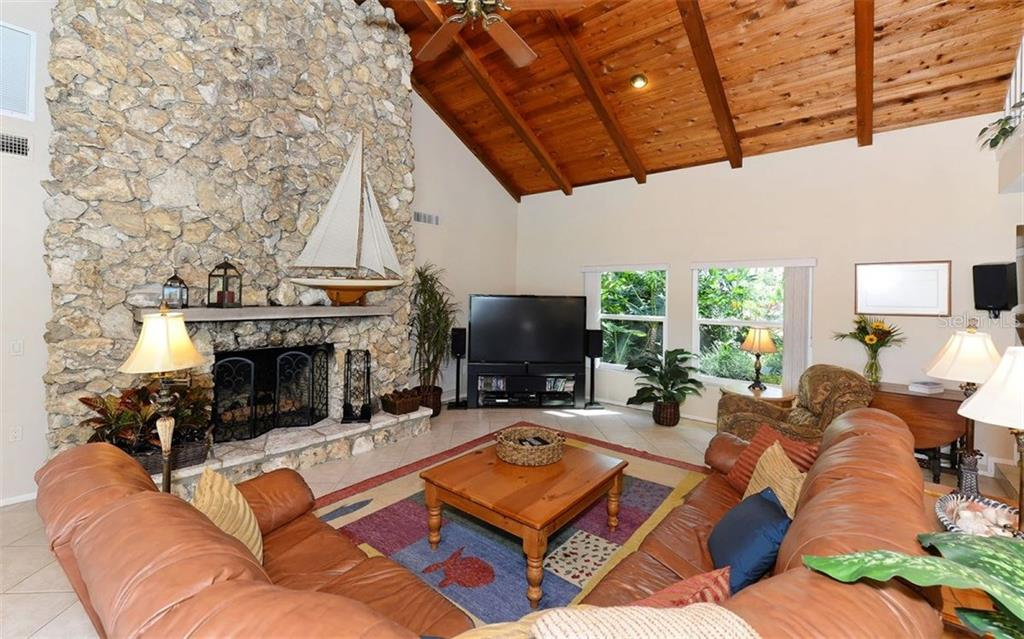2-story family room w/gas coral stone fireplace and vaulted ceilings. - Single Family Home for sale at 5122 Willow Leaf Dr, Sarasota, FL 34241 - MLS Number is A4209555