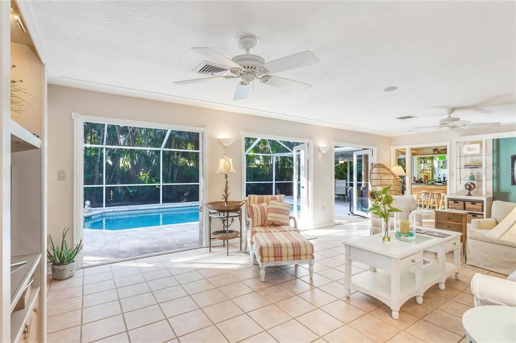 Living room with French door to lanai and swimming pool - Single Family Home for sale at 5634 Cape Leyte Dr, Sarasota, FL 34242 - MLS Number is A4209556