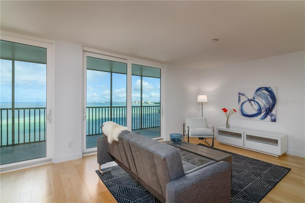 Living room with view of Big Pass and Gulf of Mexico - Condo for sale at 4822 Ocean Blvd #11d, Sarasota, FL 34242 - MLS Number is A4209955