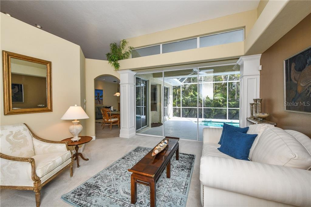 Whether relaxing after a day at the beach or entertaining family & friends, this cozy Great Room is where you will LIVE! Wall of sliders opens to the lanai & pool. - Single Family Home for sale at 5585 Siesta Estates Ct, Sarasota, FL 34242 - MLS Number is A4211109