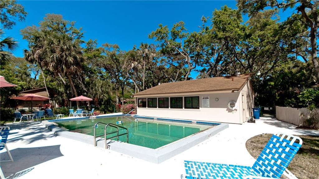 Nearby community pool and clubhouse. - Condo for sale at 5107 29th St W #n/A, Bradenton, FL 34207 - MLS Number is A4213034