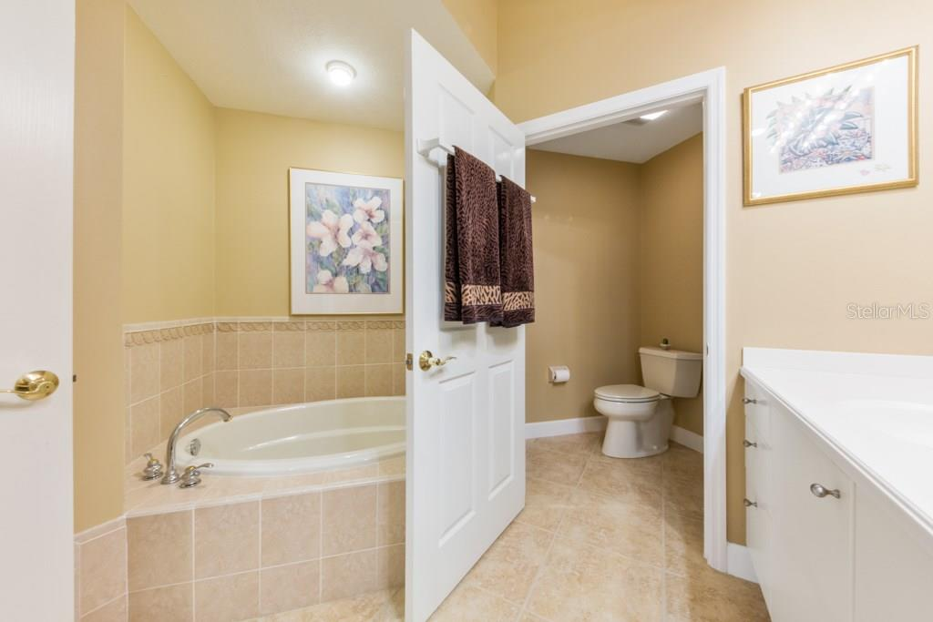 Master Bath with private water closet - Condo for sale at 7504 Botanica Pkwy #101, Sarasota, FL 34238 - MLS Number is A4213208