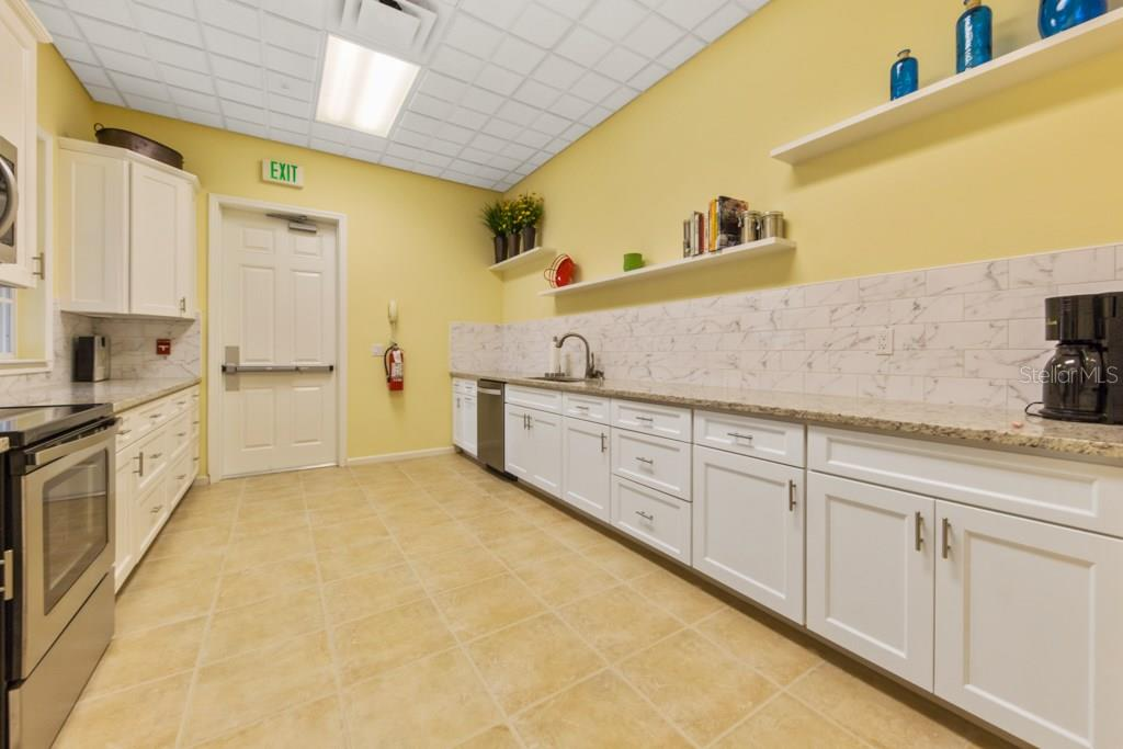 Freshly remodeled Chefs kitchen in the clubhouse - Condo for sale at 7504 Botanica Pkwy #101, Sarasota, FL 34238 - MLS Number is A4213208