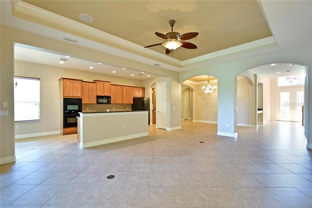 Double arched entries to the dining room and entryway. Surround sound speakers are located in the tray ceiling and Electric outlets can be found in the floor - Single Family Home for sale at 3729 Summerwind Cir, Bradenton, FL 34209 - MLS Number is A4215992