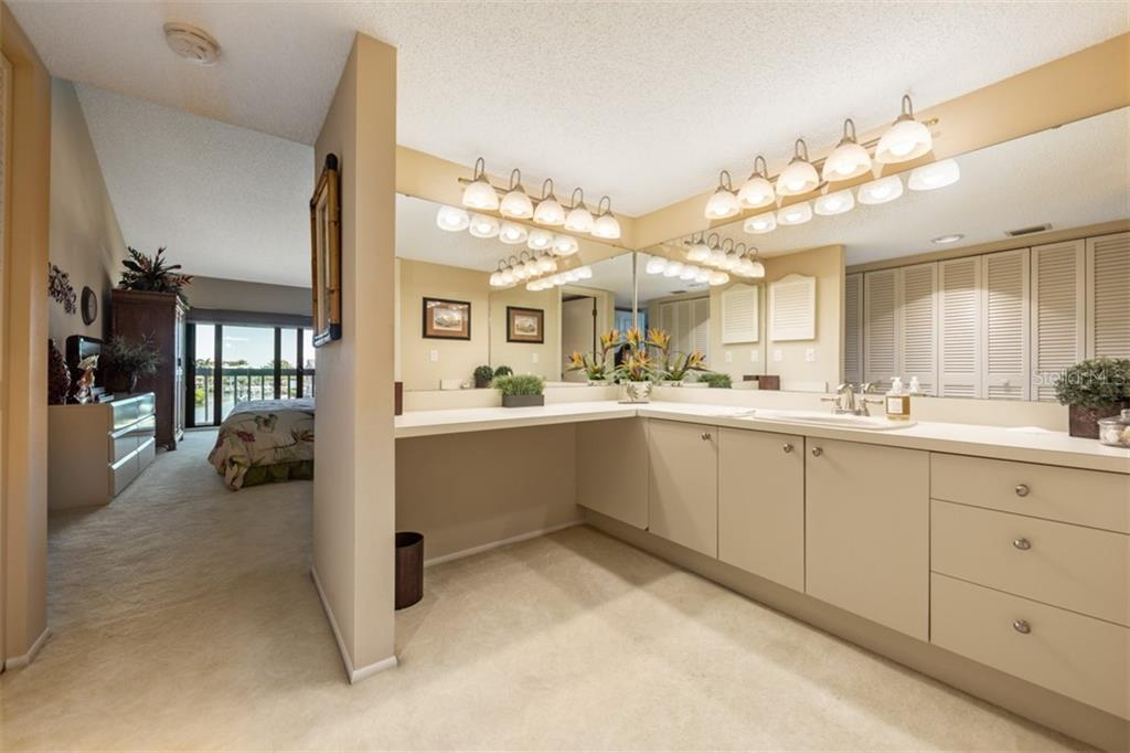 2nd Master suite with full harbor views and vaulted ceilings. - Condo for sale at 1215 Dockside Pl #204, Sarasota, FL 34242 - MLS Number is A4215997