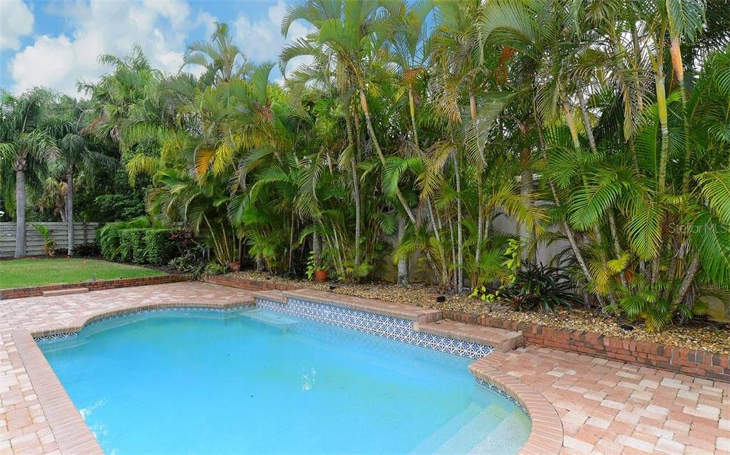 Beautifully landscaped & fenced private backyard with saltwater heated pool. - Single Family Home for sale at 1670 Bay View Dr, Sarasota, FL 34239 - MLS Number is A4400079