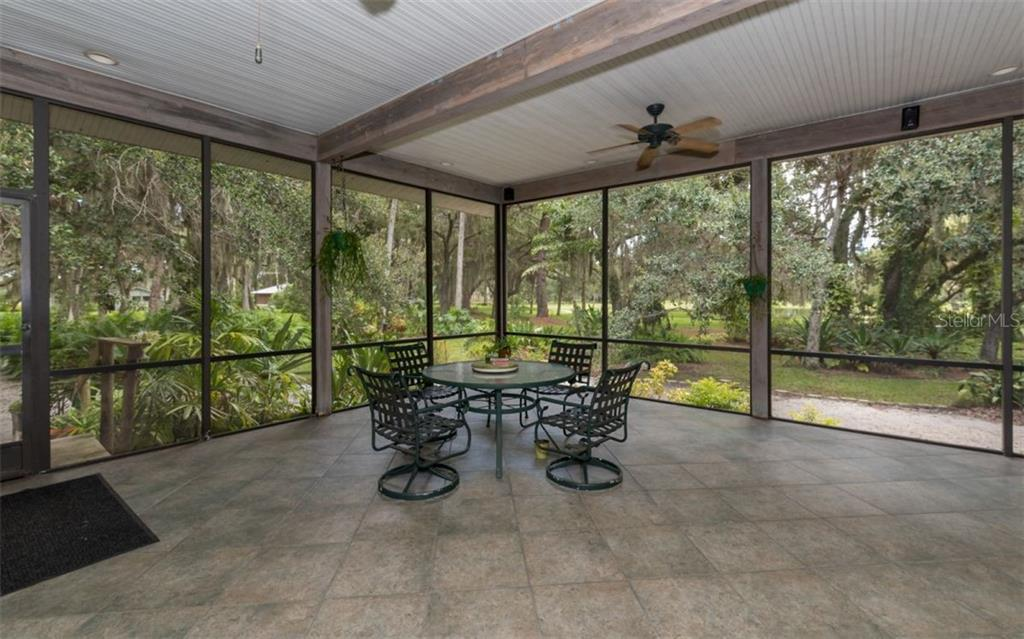 Main House L-Shaped Front Screened Porch - Single Family Home for sale at 7865 27th St E, Sarasota, FL 34243 - MLS Number is A4400492