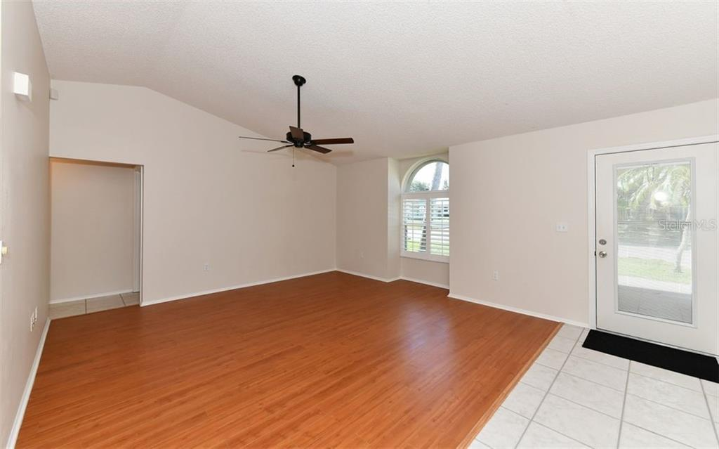 Cathedral Ceilings overlook new floors... - Single Family Home for sale at 6202 65th Ct E, Palmetto, FL 34221 - MLS Number is A4400567