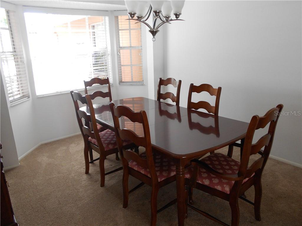 Dining room - Single Family Home for sale at 5150 Ashton Pines Ln, Sarasota, FL 34231 - MLS Number is A4400646