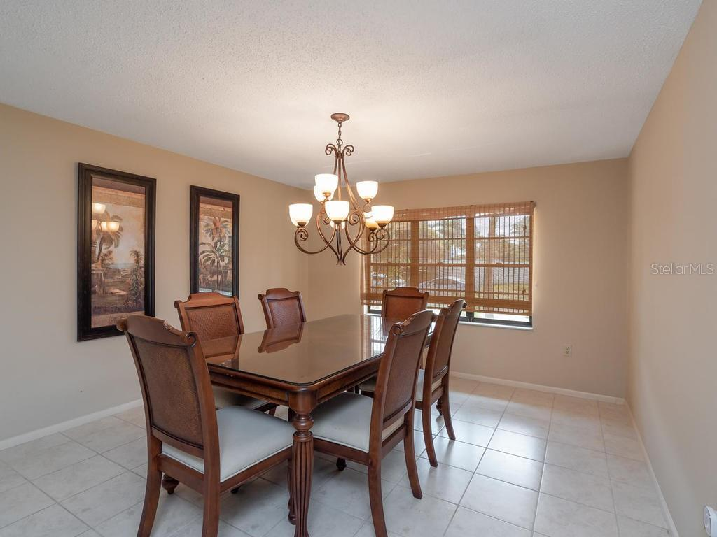 Formal dining room - Single Family Home for sale at 1173 Morningside Pl, Sarasota, FL 34236 - MLS Number is A4401654