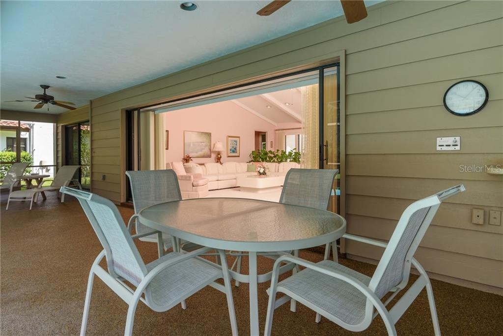 Covered Area for Dining with Ceiling Fans - Single Family Home for sale at 4973 Southern Wood Dr, Sarasota, FL 34241 - MLS Number is A4402930