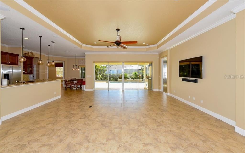 Open living, dining and kitchen area with nice open flow. - Single Family Home for sale at 533 Mast Dr, Bradenton, FL 34208 - MLS Number is A4402963