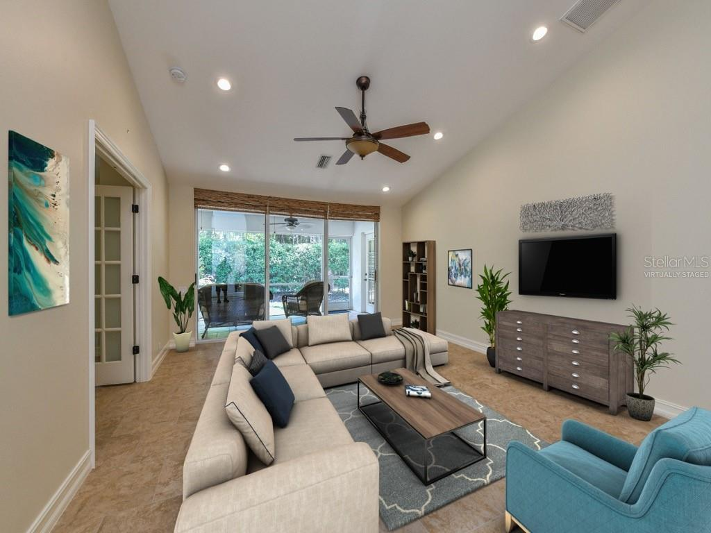 Living, great room, vaulted ceiling. (virtually staged furnishings) - Single Family Home for sale at 259 Woods Point Rd, Osprey, FL 34229 - MLS Number is A4403108