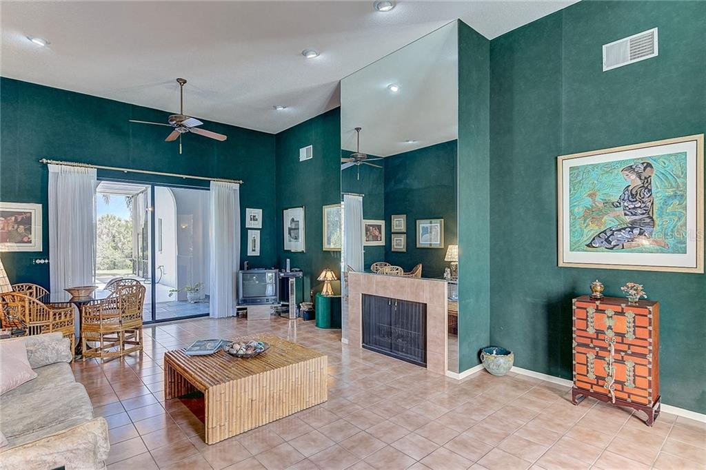 Family Room / Library opens to the lanai and pool - Single Family Home for sale at 3911 Spyglass Hill Rd, Sarasota, FL 34238 - MLS Number is A4404657
