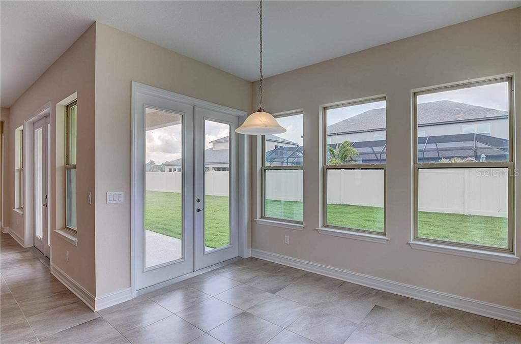 The Dinette features French doors leading out to your covered back porch! - Single Family Home for sale at 13019 Utopia Loop, Bradenton, FL 34211 - MLS Number is A4404703