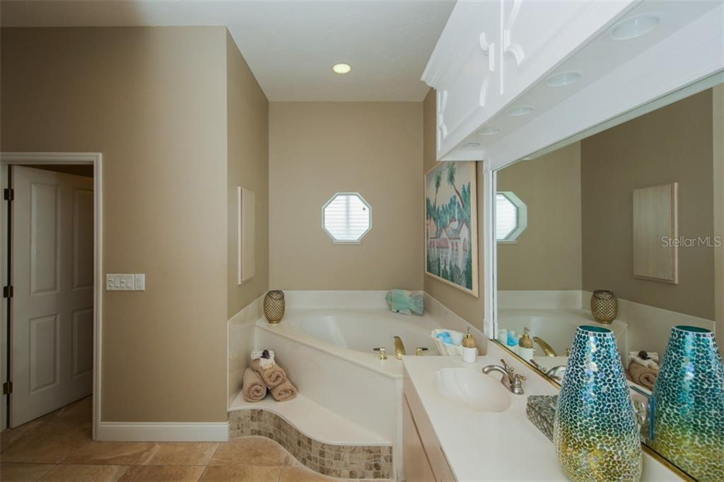 Master bath with Garden Tub and Walk-In Shower, Dual sinks - Single Family Home for sale at 1778 Bayshore Dr, Englewood, FL 34223 - MLS Number is A4405962