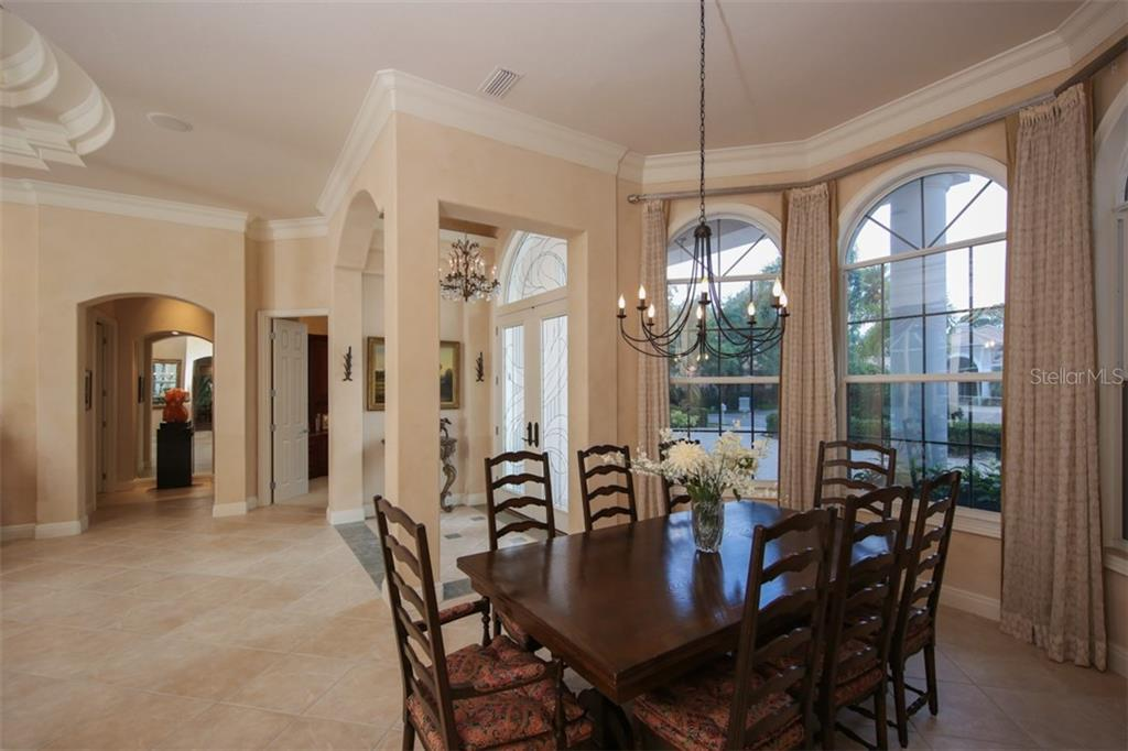 Chef's kitchen features Thermador, Bosch and Sub-Zero appliances, center island and hidden walk-in pantry. - Single Family Home for sale at 7309 Barclay Ct, University Park, FL 34201 - MLS Number is A4406768