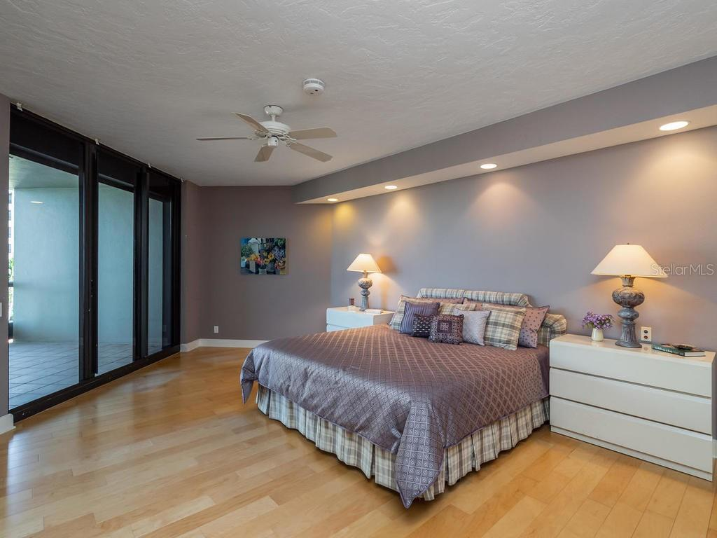 Master bedroom with 3 walk-in closets and private balcony. - Condo for sale at 1241 Gulf Of Mexico Dr #406, Longboat Key, FL 34228 - MLS Number is A4406877