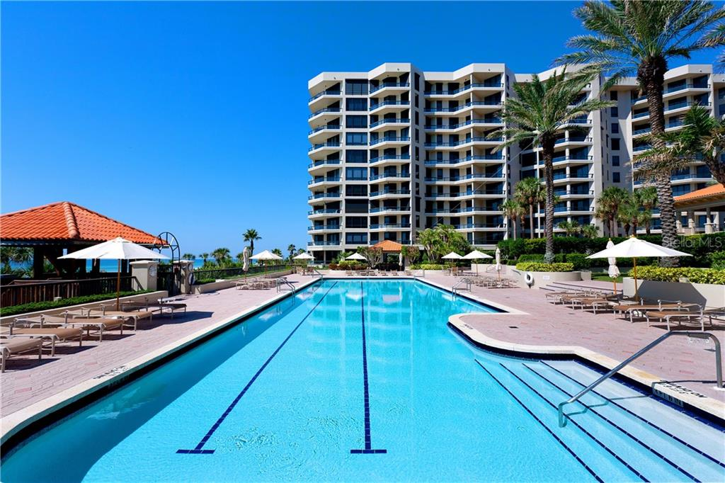 Main pool, there is also a children's pool nearby. - Condo for sale at 1241 Gulf Of Mexico Dr #406, Longboat Key, FL 34228 - MLS Number is A4406877