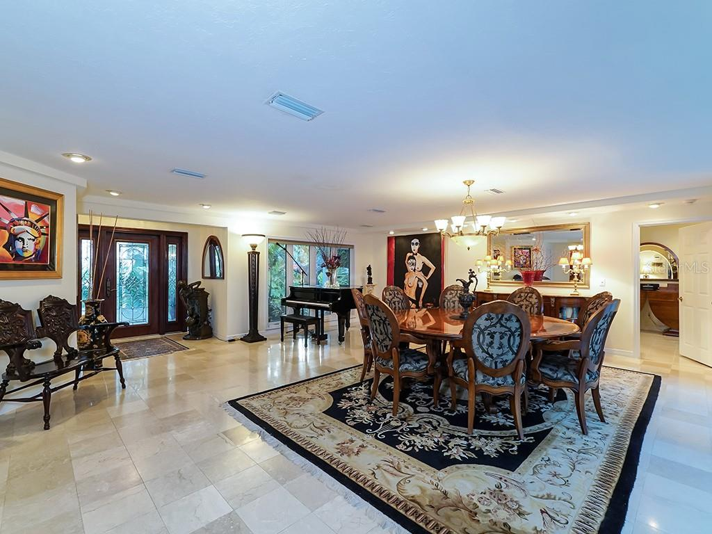 Open Great Room - Neutral Marble Flooring - Single Family Home for sale at 916 N Casey Key Rd, Osprey, FL 34229 - MLS Number is A4408082
