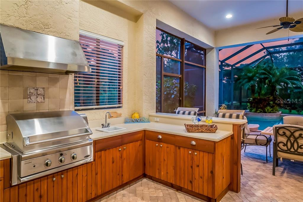 Outdoor Kitchen with spectacular views - where you'll see the occasional deer wandering past! - Single Family Home for sale at 13223 Palmers Creek Ter, Lakewood Ranch, FL 34202 - MLS Number is A4408290