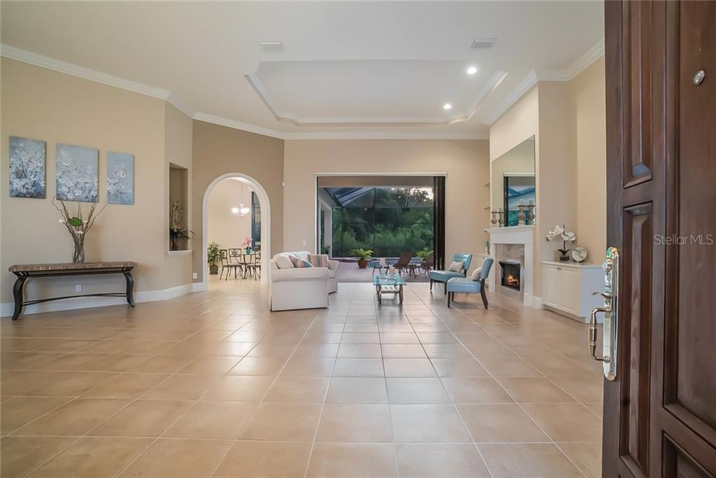 Enter the front doors to the formal living room with triple, pocket sliders to the pool and preserve. Great large space for entertaining, features a gas fireplace. - Single Family Home for sale at 13223 Palmers Creek Ter, Lakewood Ranch, FL 34202 - MLS Number is A4408290