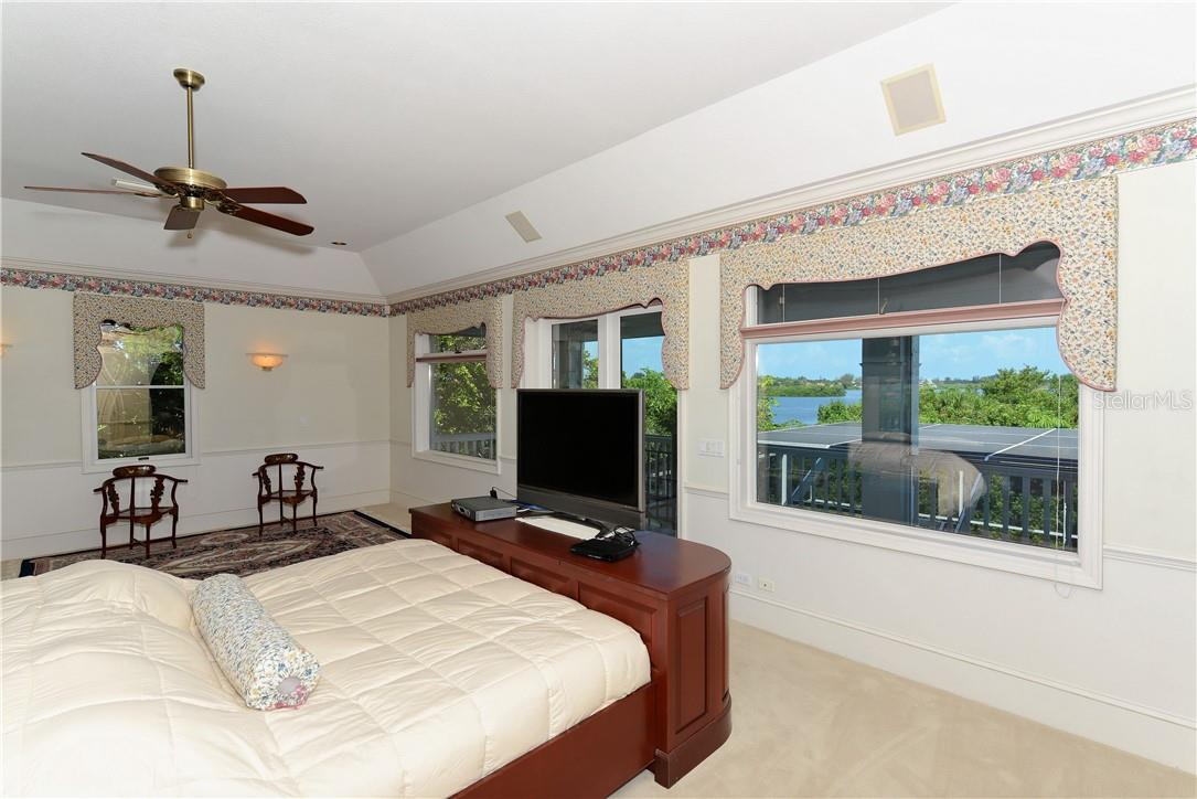 Master bedroom with view of the bay. - Single Family Home for sale at 1427 Cedar Bay Ln, Sarasota, FL 34231 - MLS Number is A4408881