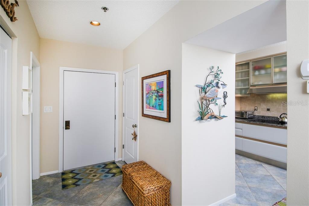 Front Hallway - Condo for sale at 1910 Harbourside Dr #503, Longboat Key, FL 34228 - MLS Number is A4409634