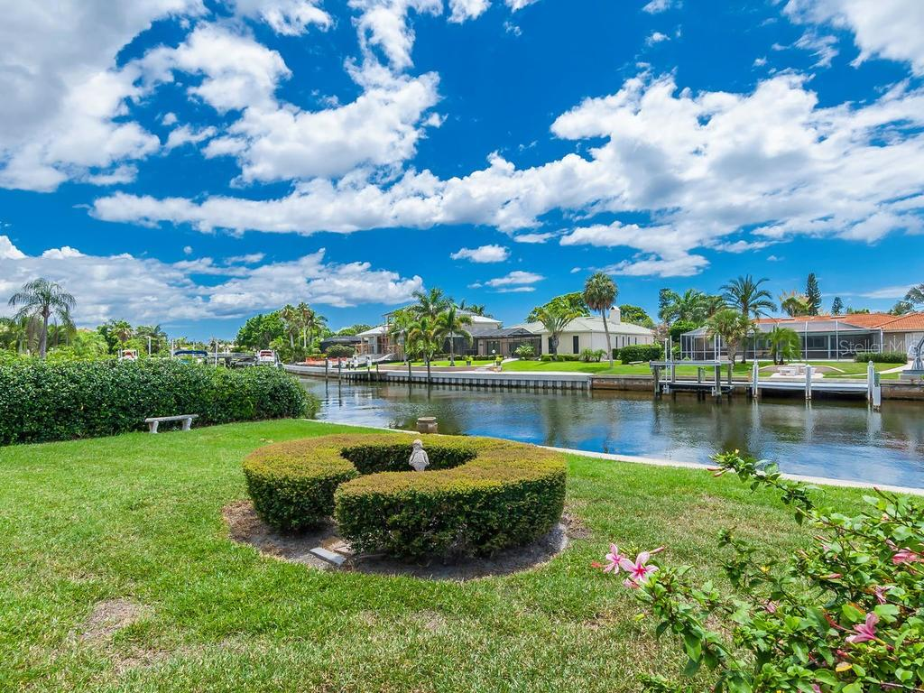 Backyard with water views - Single Family Home for sale at 422 Meadow Lark Dr, Sarasota, FL 34236 - MLS Number is A4410562