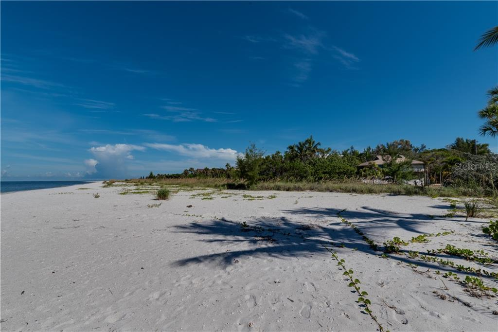 Beach view - Single Family Home for sale at 6661 Gulf Of Mexico Dr, Longboat Key, FL 34228 - MLS Number is A4410988