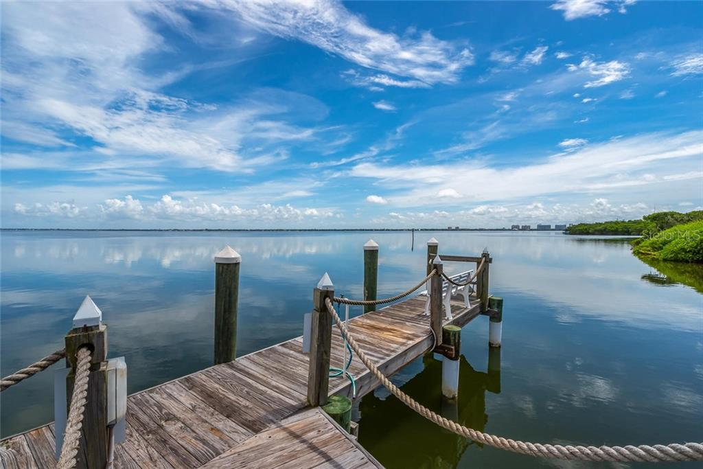 Tangerine Bay Club provides a private fishing pier and day dock! - Condo for sale at 340 Gulf Of Mexico Dr #116, Longboat Key, FL 34228 - MLS Number is A4411000