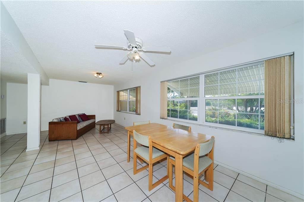 First floor great room off of the garage - Single Family Home for sale at 5591 Cape Aqua Dr, Sarasota, FL 34242 - MLS Number is A4411099